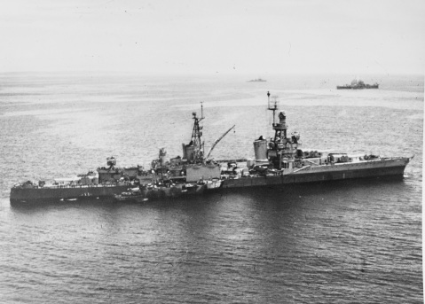 USS LOUISVILLE (CA-28) off the Southern coast of Okinawa, 30 May 1945. She was hit by a kamikaze a few days later. LCI-1090 is alongside. Description: Catalog #: 80-G-K-5827