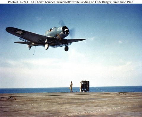 Douglas SBD Dauntless scout bomber Goes around for another landing attempt, after being waved off by the Landing Signal Officer on USS Ranger (CV-4), circa June 1942. Official U.S. Navy Photograph, now in the collections of the National Archives. NHHC Catalog #: 80-G-K-741