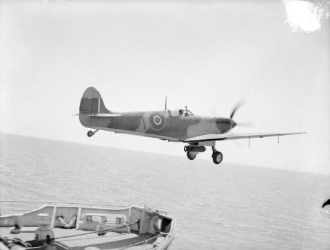A Seafire III, bombed up ready for action, taking off from the KHEDIVE. IWM A 25493