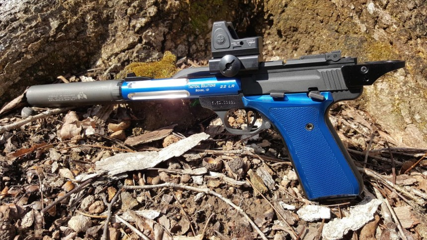 Browning buckmark Tactical Solutions Trail-Lite threaded 5.5-inch barrel Tandemkross Victory trigger and Halo slide system Trijicon SilencerCo Sparrow 22plink