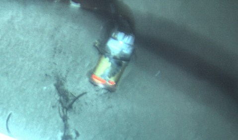 El Faro's VDR seen in the sand at a depth of 15,000 feet off the Bahamas. Photo credit NTSB