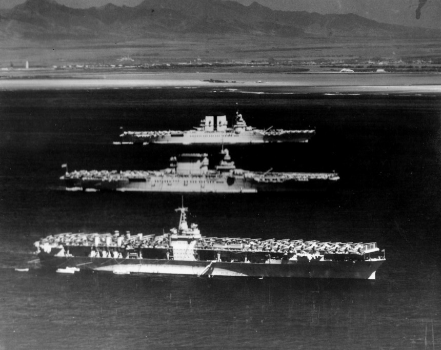 Pacific flattops, front to back, the carriers Ranger (CV-4), Lexington (CV-2), and Saratoga (CV-3) pictured at anchor off Honolulu, Territory of Hawaii. 4 August 1936