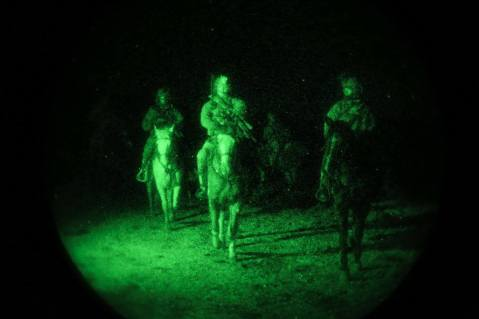 Man don't those white horses glow at night! Green Berets from 3rd Special Forces Group (Airborne) ride horses to travel through rough terrain during a site reconnaissance training exercise on March 1, 2016 in Nevada. (U.S. Army photo by 3rd SFG (A) Combat Camera)
