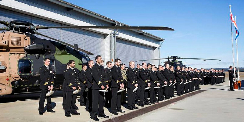 Members of 808 Squadron bow their heads for the Naval Prayer, during the commissioning of 808 Squadron held at HMAS Albatross.