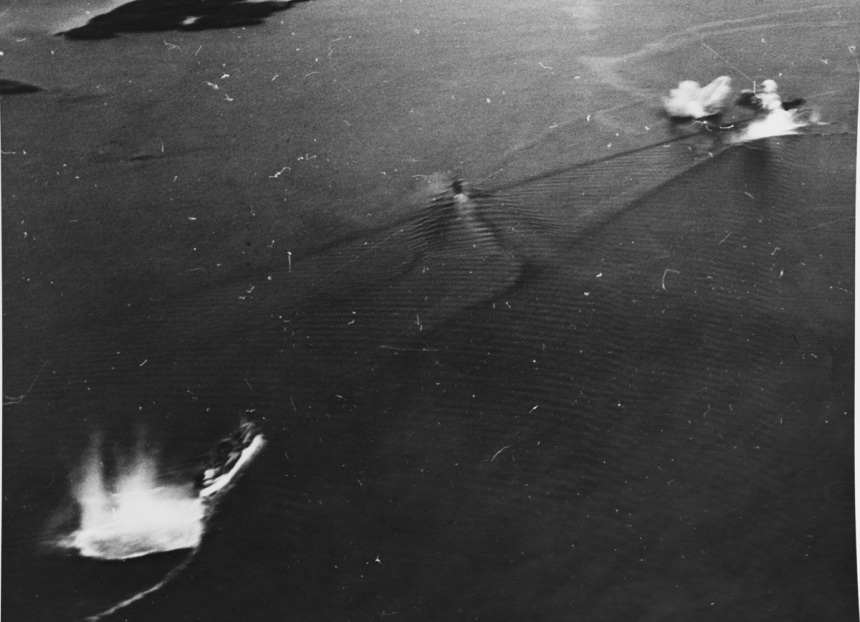 Aircraft attack on enemy shipping, Bodo Harbor, Norway, showing direct hit amidships on 5000 GT M/V, 4 October 1943. NHC Catalog #: NH 84270