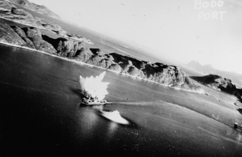 Aircraft attack on enemy shipping, Bodo Harbor, Norway, showing SAAR under attack, 4 October 1943. NHHC Catalog #: NH 84271