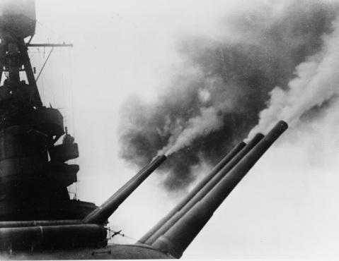 """Shells Attu, 11 May 1943. View of forward 8"""" guns in action. Description: Catalog #: NH 92382"""