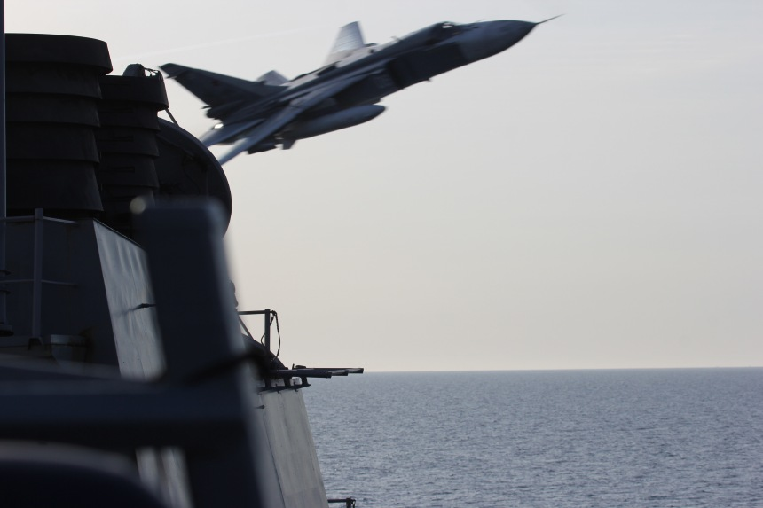 160412-N-ZZ999-008 BALTIC SEA (April 12, 2016) A Russian Sukhoi Su-24 attack aircraft makes a very low altitude pass by USS Donald Cook (DDG 75) April 12, 2016. Donald Cook, an Arleigh Burke-class guided-missile destroyer forward deployed to Rota, Spain, is conducting a routine patrol in the U.S. 6th Fleet area of operations in support of U.S. national security interests in Europe. (U.S. Navy photo/Released)