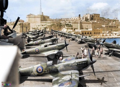 Supermarine Seafire L.IIIs of RNAS 808 Squadron on the deck of the escort aircraft carrier HMS Khedive (02), entering the Grand Harbour of Valletta in Malta. July 1944
