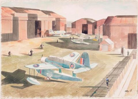 three Kingfisher seaplanes stand in an aerodrome consisting of corrugated metal hangars painted with camouflage patterns Pitchforth, Roland Vivian