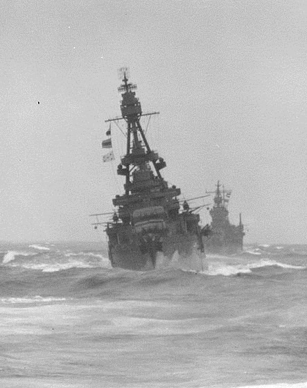 USS Louisville (CA 28) operating in the Bering Sea during May 1943. She is followed by USS San Francisco (CA 38).