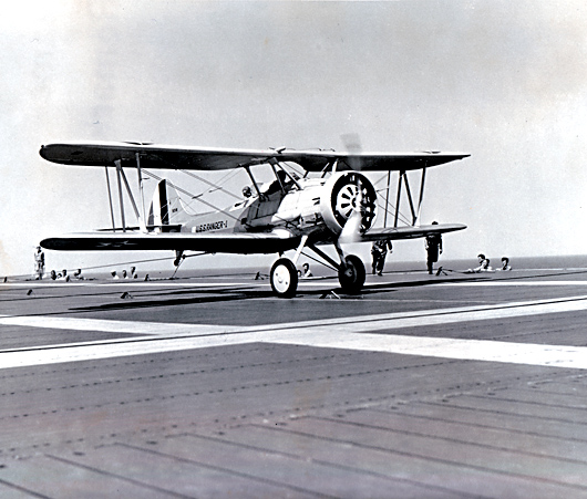 First landing on the USS Ranger. Lt Cmdr. A. C. Davis, pilot, H. E. Wallace, ACMM, passenger. June 21, 1934