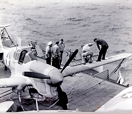Loading 50-caliber machine gun of Army P40-F aboard the USS Ranger while in route to North Africa. January 17, 1943. In all she would ship 215 P-40s and 70 P-38s to Africa in four separate trips for the Army between April 1942 and April 1944