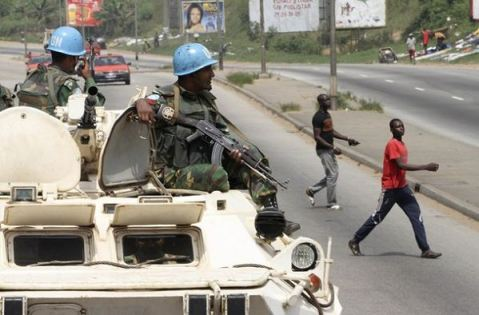 Bangladeshi UN soldiers sit on top of armoured vehicles during a patrol in Abidjan, Ivory Coast, photo via AFP