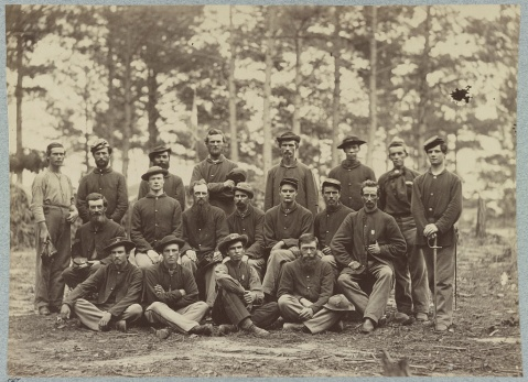 Co. B, U.S. Engineers in front of Petersburg, Va., August, 1864 Sgt. Harlan Cobb seated on the ground, third from left, wearing a vest.