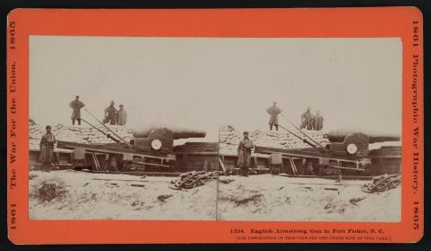 Fort fisher Stereograph showing a Confederate soldier in the battery with an English Armstrong gun. Three men stand behind him