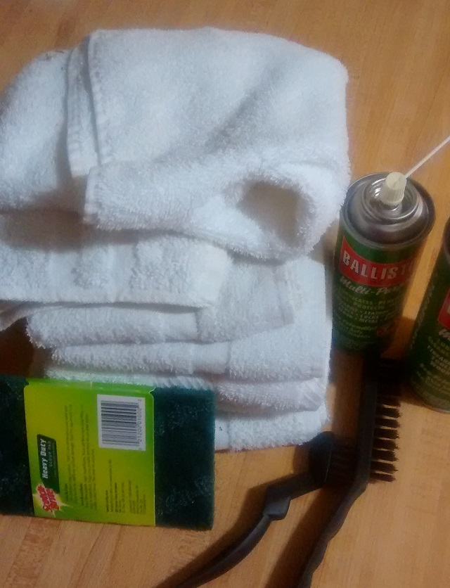 Stack of hotel handtowels, both aerosol and non-aerosol Ballistol, direct from Germany, brass and plastic brushes, green pads