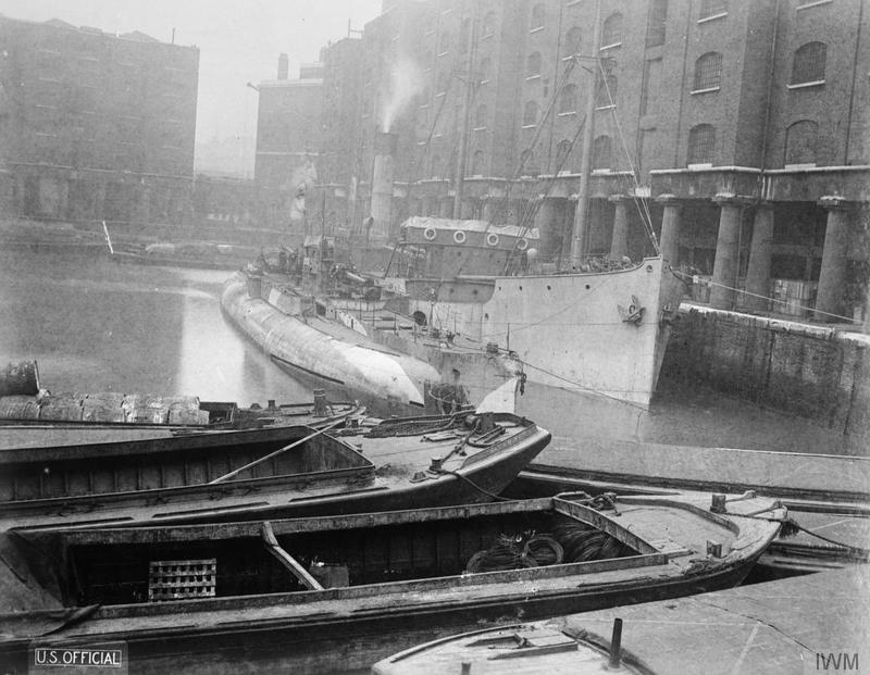 German U-Boat U-155 surrendered to the British, lying alongside the British mystery ship HMS SUFFOLK COAST at St. Katherine's Docks in London, 4 December 1918 (iwm)