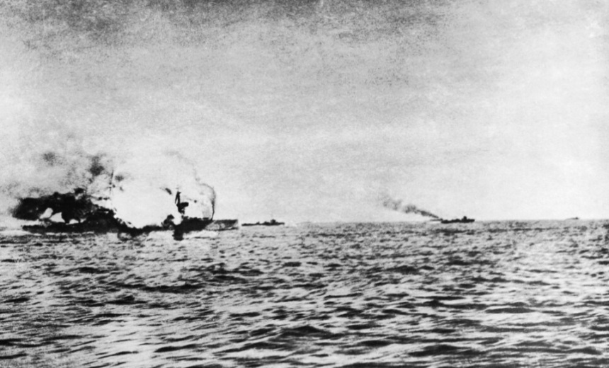 """HMS INVINCIBLE explodes during the battle of Jutland after she was hit five times by shells from the German battlecruisers DERRFLINGER and LUTZOW, the last hit blowing the roof off """"Q"""" turret and setting fire to the cordite propellant, the flash soon spread to the magazine and INVINCIBLE was ripped in two by the explosion. There were only three survivors with those killed including Rear-Admiral The Hon Horace Hood IWM SP 2468"""