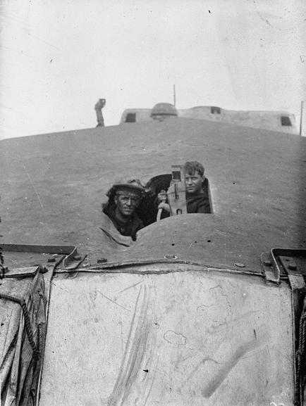 Looking through a shell-hole in HMS Tiger after Jutland