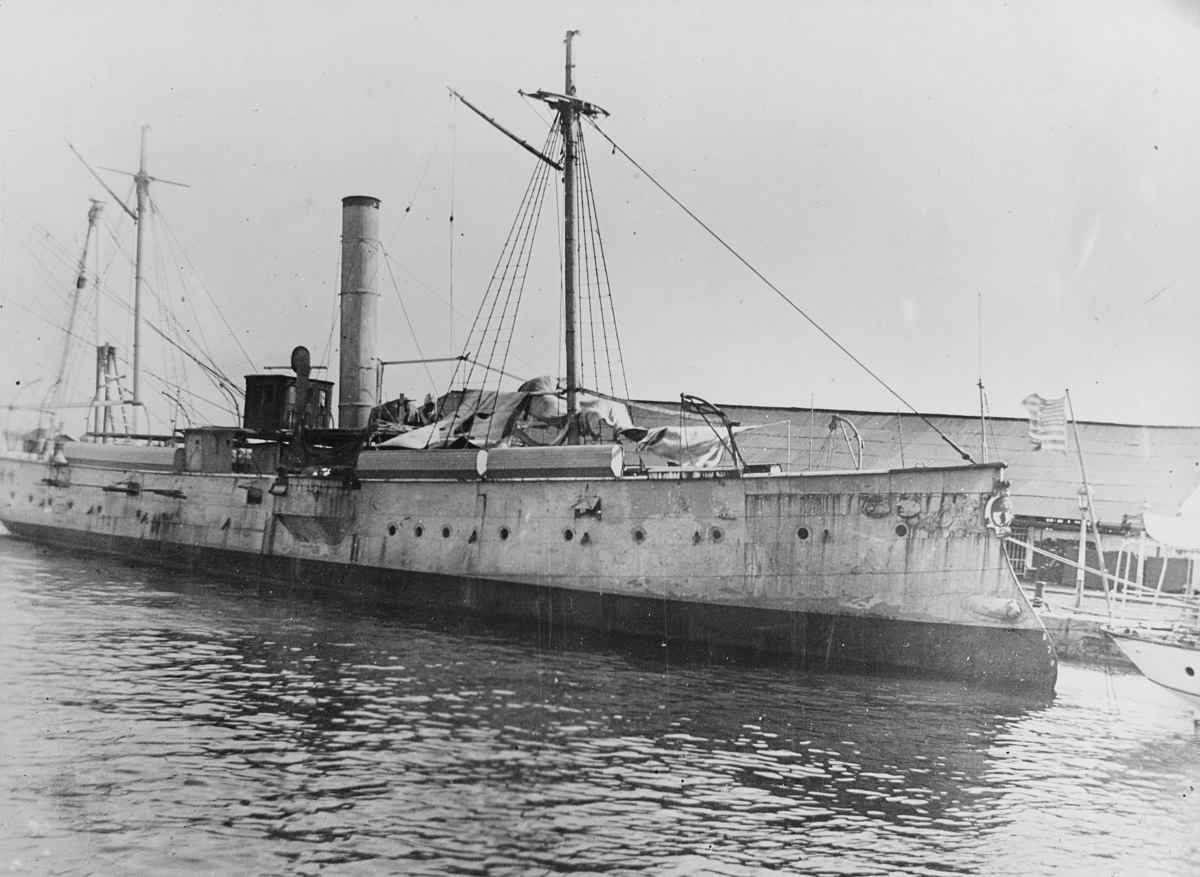 USS ELCANO (PG-38) at Cavite Navy Yard, Philippine Island circa 1900, before being refitted for the U.S. Navy. Note she has been white-washed and her awning shown above in Spanish service deleted. Description: Courtesy of LCDR John E. Lewis, 1945. Catalog #: NH 54353