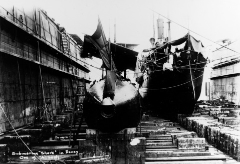 USS Shark (Submarine # 8) In the Dewey Drydock, Olongapo Naval Station, Philippines, circa 1910. The gunboat Elcano is also in the drydock, in the right background. Courtesy of Donald M. McPherson, 1978. U.S. Naval History and Heritage Command Photograph. Catalog #: NH 86963
