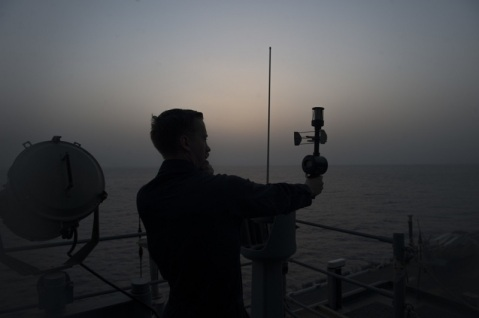 160530-N-OF476-141 GULF OF ADEN (May 30, 2016) Aerographer's Mate Airman Apprentice Jackson McMullan uses a handheld anemometer to measure wind speed just before sunrise on vultures row aboard amphibious assault ship USS Boxer (LHD 4). Boxer is the flagship for the Boxer Amphibious Ready Group and, with the embarked 13th Marine Expeditionary Unit, is deployed in support of maritime security operations and theater security cooperation efforts in the U.S. 5th Fleet area of operations. (U.S. Navy photo by Mass Communication Specialist Seaman Eric Burgett/Released)