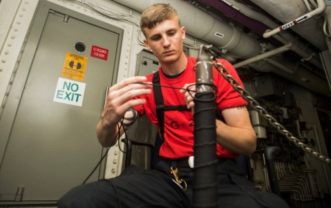 160623-N-JQ675-013 MEDITERRANEAN SEA (June 22, 2016)- Aviation Ordnanceman Airman Michael Lease ties a line on a pole in a passageway of the aircraft carrier USS Dwight D. Eisenhower (CVN 69) (Ike). Ike, the flagship of the Eisenhower Carrier Strike Group, is conducting naval operations in the U.S. 6th Fleet area of operations in support of U.S. national security interests in Europe. (U.S. Navy photo by Mass Communication Specialist Seaman Apprentice Neo Greene III/Released)