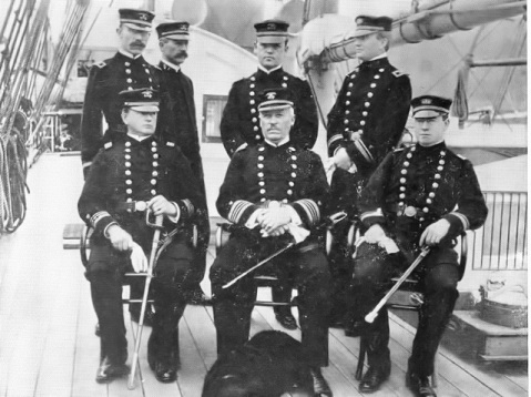 Officers of the Cutter THETIS circa 1904. Note the USRCS shields on their uniforms and the dog at their heels