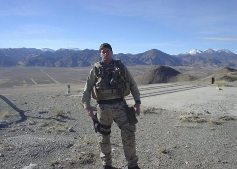 Petty Officer Second Class (SEAL) Michael A. Monsoor poses for a photo in Hawthorne Nev.. He was postumously awarded the MOH after he leap on a live grenade saving the lives of two fellow SEALs