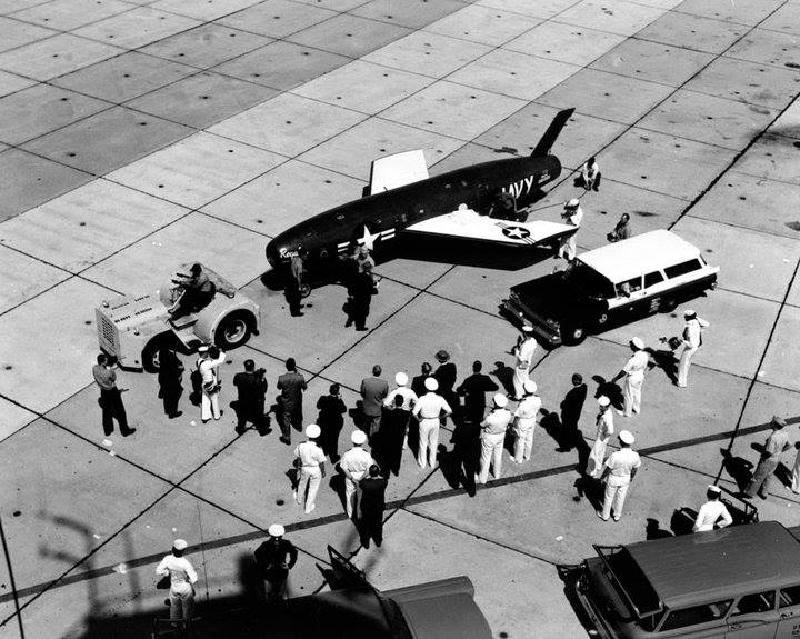 Reporters and photographers patiently wait the removal of the first Missile Mail from Regulus. The missile was fired from USS Barbero (SS 317) and landed Mayport, Florida