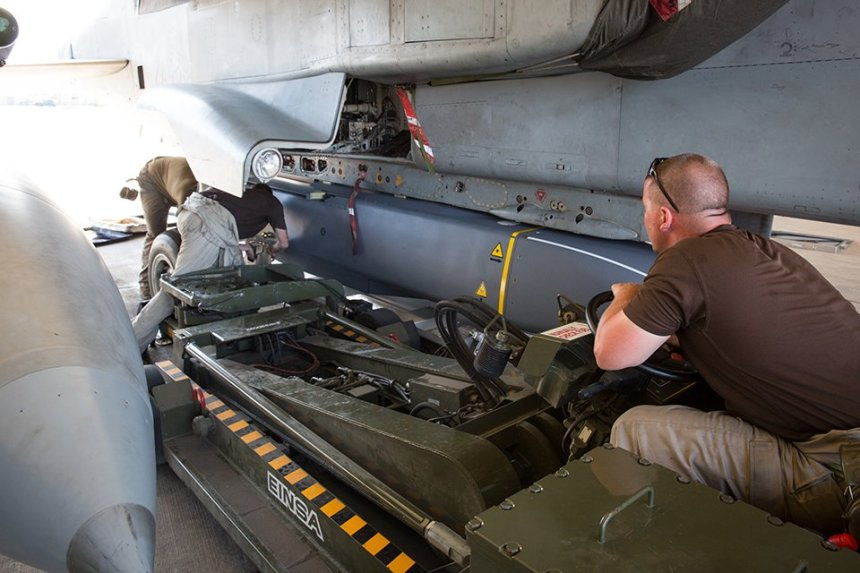 Armourers from 903 Expeditionary Air Wing (EAW) based out of Royal Air Force Akrotiri, Cyprus load a Tornado GR4 with Stormshadow cruise missiles. Crown Copyright.