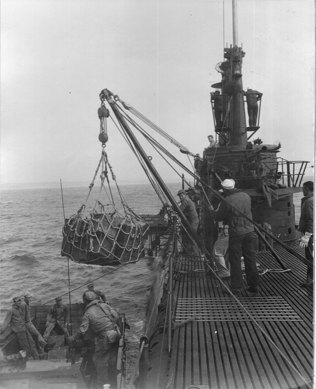Using sling and cargo boom to lower cargo into LVT from Barbero (SSA-317) on 10 March 1949. USN photo # 80-G-422914 by PFC William R. Keating, from NARA, College Park, Maryland, courtesy of Sean Hert.