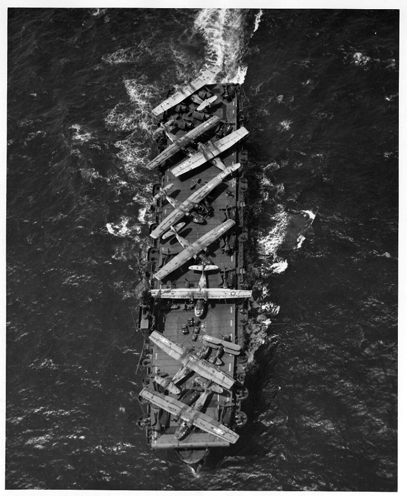 USS Thetis Bay pictured underway transporting PBY Catalinas and other aircraft in need of repair to Alameda,CA. July 8,1944