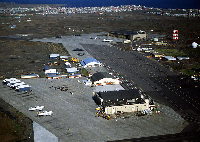 A view of the U.S. Naval Air Station Keflavik, 19 August 1982. In the foreground are the ramp areas and facilities of the U.S. Air Force 57th Fighter Interceptor Squadron, with other facilities in the background. The two aircraft in the foreground are Lockheed P-3Cs of U.S. Navy patrol yquadron VP-26 Tridents. Also visible are three USAF McDonnell Douglas F-4C/D Phantom II fighters. In the background are three Lockheed HC-130 Hercules´, a Lockheed C-141B Starlifter, a Boeing KC-135A Stratotanker and a Boeing E-3A Sentry.