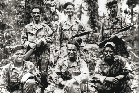 A team of Alamo Scouts pose for a photo after completing a reconnaissance mission on Los Negros Island, February 1944.