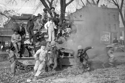 Boys playing on M1917 tank, Raton, New Mexico 1920