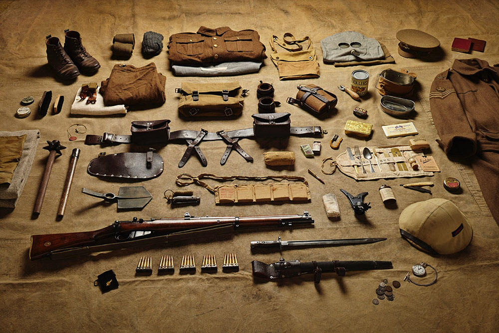 British/Commonwealth. Note the SMLE .303 with bayonet and wirecutting accessory just off the muzzle. Also the extensive field mess kit. To the left there is the classic non-standard trench mace and the E-tool handle with pike/shovel blade.