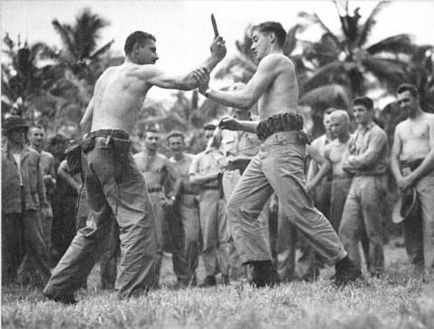 During World War II, two Marine Raider instructors demonstrate the dexterity required for hand-to-hand knife fighting ka bar
