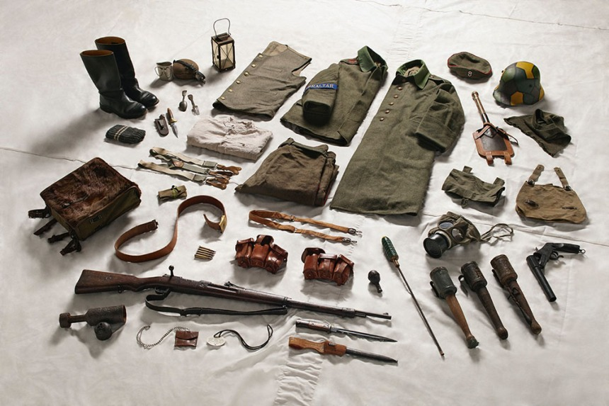 German. Note the camoflauged Stalhelm at the top right and the rifle grenade near the muzzle of the Gew 98 Mauser.