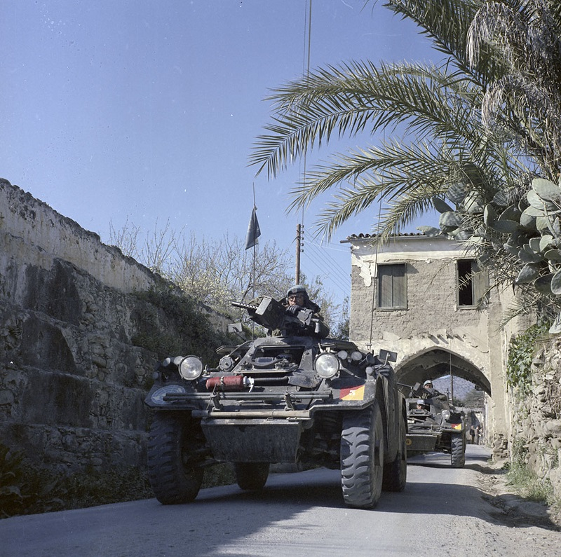 RCD Ferret on patrol in Cyprus. (Library and Archives Canada Photos) Note the Browning M1919 7.62x51mm LMGs and how the Ferret's small signature made for easy movement along ancient Mediterranean streets