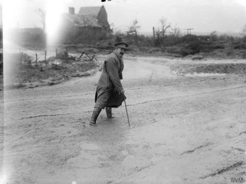 The war artist Lieutenant Muirhead Bone crossing a muddy road, Maricourt, September 1916. IWM