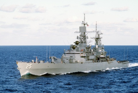 A port bow view of the nuclear-powered guided missile cruiser USS BAINBRIDGE (CGN-25) underway. When she was commissioned as a destroyer in 1961, she broke with the oil-fired steam Navy of the past