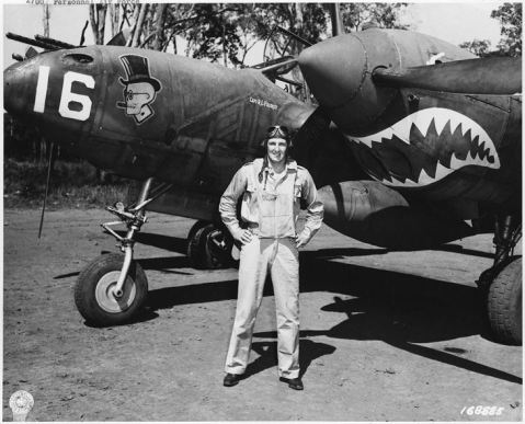 Captain Robert L. Faurot with P-38F Lightning 42-12623 Nose 16 parked at 14 Mile Drome (Schwimmer) Credit: US Army Signal Corps, NARA SC-168885 Date: January 20, 1943