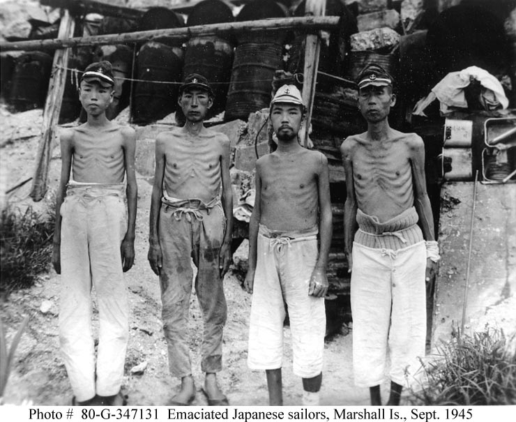 "Photo #: 80-G-347131. Emaciated Japanese Naval Personnel. Photographed at a Japanese hospital in the Marshall Islands, 15 September 1945. They show the effects of the blockade and constant bombardment of ""bypassed"" Japanese-held islands in the central Pacific over the last year-and-a-half of World War II. Location is probably Wotje or Maloelap Atoll. Photographed by Photographer's Mate First Class Louis Lazarow, of Naval Air Base, Majuro."