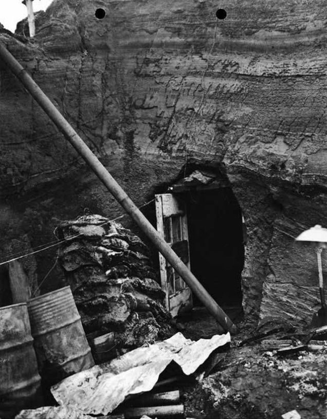 Entrance to tunnel near Japanese sub base on Kiska, August 1943. Tunnels gave protection to the Japanese against bombs and provided sleeping quarters; image and caption Alaska State Library/Alaska's Digital Archives (as with three following images). http://vilda.alaska.edu/cdm/search/collection/cdmg21/searchterm/kiska%20submarine/order/nosort