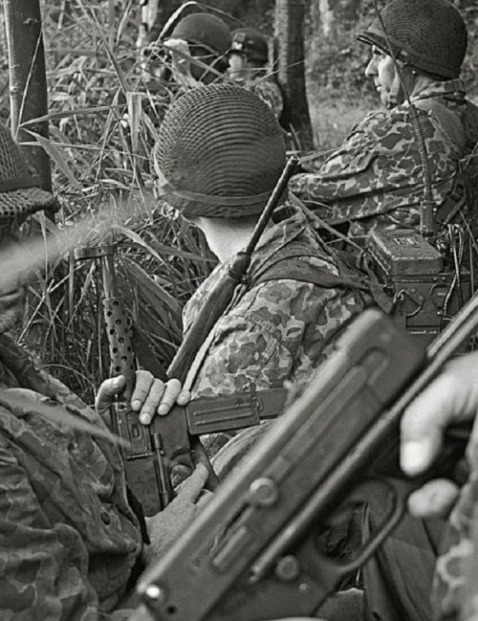 HBT clad French Paratroops in Indochina circa 1953 ready their Mat 49 sub machine guns for a assault on Viet Minh guerrillas
