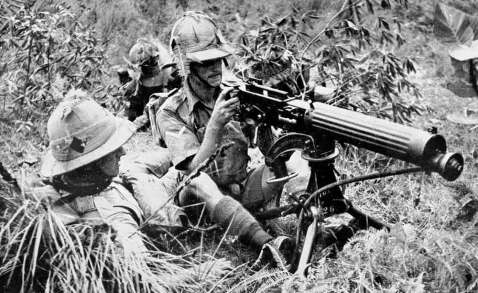 Manchester Regiment sit with their wwi era Vickers gun during a demonstration of preparedness for jungle warfare in Malaya, circa August 1941
