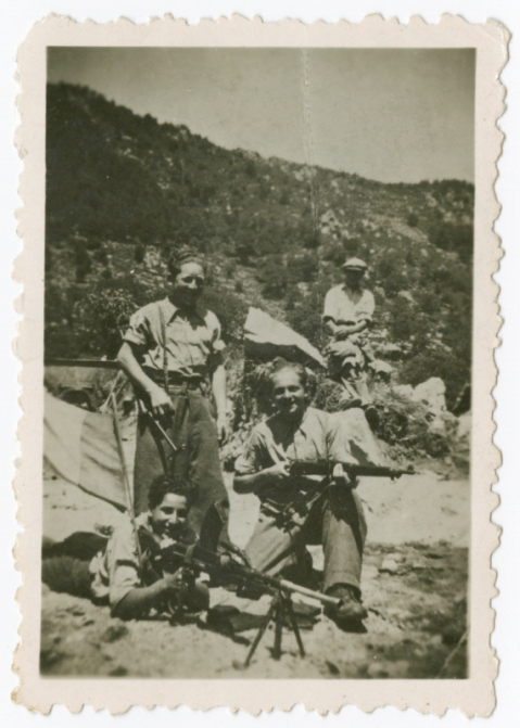 Caption: Members of the 108th company of the F.T.P.F. (Francs-tireurs et partisans français), the communist resistance group pose with their weapons at a mountain base. Photo: United States Holocaust Memorial Museum, courtesy of Marion Loewenstein