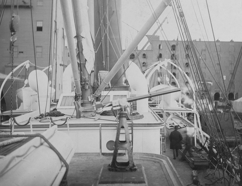 View on board, probably taken while fitting out for Brazilian Navy service in November 1893 at the Morgan Iron Works, New York City. Shown looking forward from near the stern, aft of the main mast. The gun is probably one of the ship's nine one-pounder Hotchkiss quick-fire weapons, eight of which were mounted on top of the deckhouses. She also had two 1-pounder Hotchkiss machine guns on top of the pilothouse. U.S. Naval History and Heritage Command Photograph. Catalog #: NH 105943